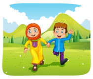 Muslim boy and girl holding hands Royalty Free Stock Images