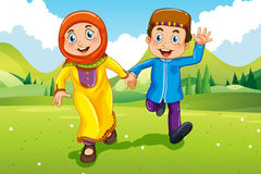 Muslim boy and girl holding hands Stock Photography