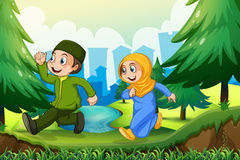 Muslim boy and girl in the park Stock Photography