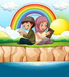 Muslim boy and girl reading book Stock Images