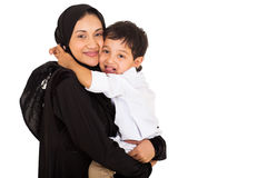 Muslim boy hugging mother Stock Image
