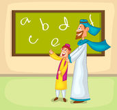 Muslim boy learning from parent Royalty Free Stock Photos