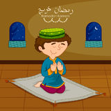 Muslim boy offering namaaz on Eid for Ramadan background. In vector stock illustration
