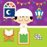 Muslim boy praying Stock Image
