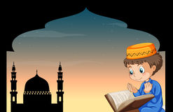Muslim boy praying with mosque background Royalty Free Stock Photos