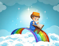 Muslim boy praying over the rainbow Royalty Free Stock Images