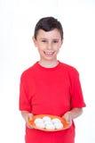 Muslim boy presenting kahk cookies  Stock Photo