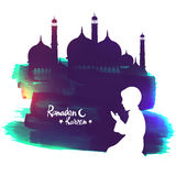 Muslim boy for Ramadan Kareem celebration. White silhouette of a Islamic boy offering Namaz (Muslims Prayer) in front of a creative Mosque for Ramadan Kareem
