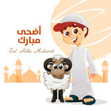Muslim Boy with Sheep. Happy Feast Written in Arabic, Traditional Eid Concept Stock Image