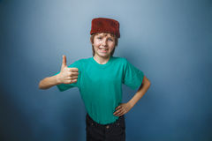 Muslim boy of ten years, skullcap, thumbs up on a Royalty Free Stock Photo