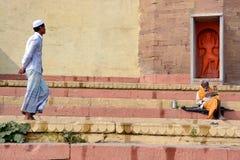 Muslim boy walking at varanasi ganga ghat