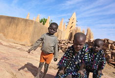 Muslim boys in Mali. Young boys in front of a mud made mosk in Mali Royalty Free Stock Photo