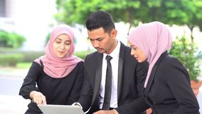 Muslim business people discussion. With laptop, outdoor stock video