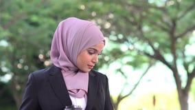 Muslim business woman going to work. Muslim business woman drinking coffee while going to work in morning stock video