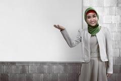 Muslim business woman show something Stock Photo