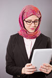 Muslim business woman. With tablet Stock Images