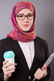 Muslim business woman. With tablet and coffee Stock Photo