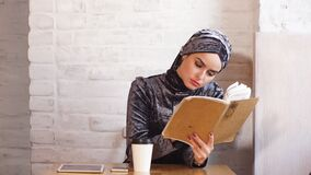 Muslim Business Woman Working Documents in Cafe. Muslim Business Woman Working Documents in Cafe stock video