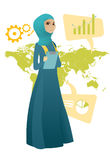 Muslim business woman working in global business. Business woman taking part in global business. Business woman standing on the background of map. Global Stock Photos