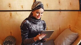 Muslim Business Woman Working on Tablet in Cafe.  stock video footage