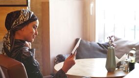Muslim Business Woman Working on Tablet in Cafe.  stock video