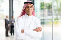 Muslim businessman arms crossed Stock Images