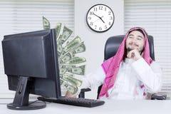 Muslim businessman looking at money stock photo