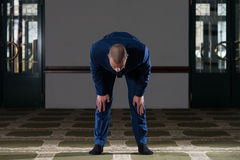 Muslim Businessman Is Praying In The Mosque Royalty Free Stock Images