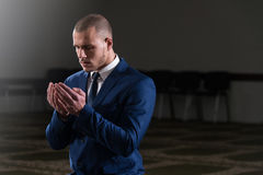 Muslim Businessman Is Praying In The Mosque Stock Photo