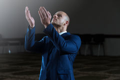 Muslim Businessman Is Praying In The Mosque Royalty Free Stock Photography