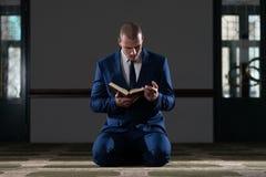 Muslim Businessman Reading Holy Islamic Book Koran Stock Photography