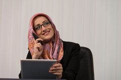 Muslim Businesswoman Talking On Telephone In Office Royalty Free Stock Image