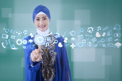 Muslim businesswoman using modern interface Stock Photo