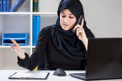 Muslim businesswoman during work Stock Photos