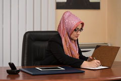 Muslim Businesswoman Working With Documents In The Office Stock Images
