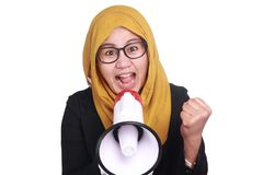 Muslim Businesswoman Yelling Motivating with Megaphone. Portrait of muslim businesswoman leader manager wearing hijab shouting yelling motivating with megaphone Royalty Free Stock Photos