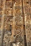 Muslim caligraphy. Piecies of restored mosque doorway in Delhi Kutub Minar Royalty Free Stock Photo