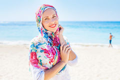 Muslim caucasian (russian) woman wearing red dress Royalty Free Stock Photography