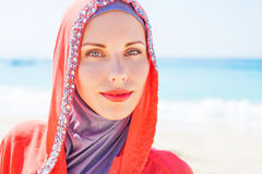 Muslim caucasian (russian) woman wearing red dress Royalty Free Stock Image