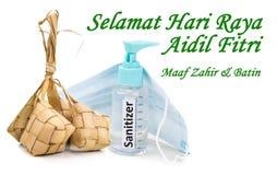 Muslim Celebration greeting or Selamat Hari Raya Aidilfitri with rice dumpling and sanitizer, face mask for protection
