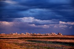 Muslim cemetery at sunset on background of storm clouds Royalty Free Stock Photos