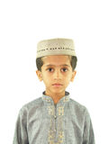 Muslim child. A young Muslim boy in a traditional attire, isolated on a white background Royalty Free Stock Photography