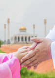 Muslim child greeting her father Royalty Free Stock Photo