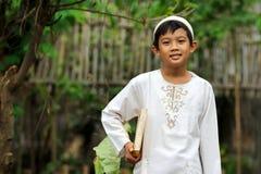 Muslim Child Holding Koran Royalty Free Stock Image