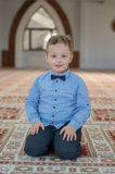 Muslim child in mosque. Muslim child pray in mosque royalty free stock images