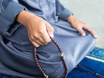 Muslim child praying for Allah Stock Photos