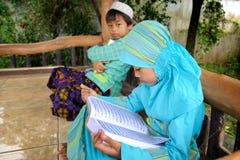 Muslim Child Reading Koran, Indonesia Stock Photography