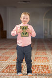 Muslim child reading Koran. In mosque Royalty Free Stock Photo