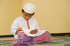 Muslim Child Reading Qur'an, Ramadan Royalty Free Stock Photography