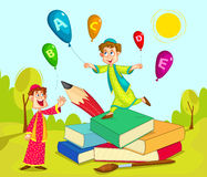 Muslim children playing with book and pencil Royalty Free Stock Photos